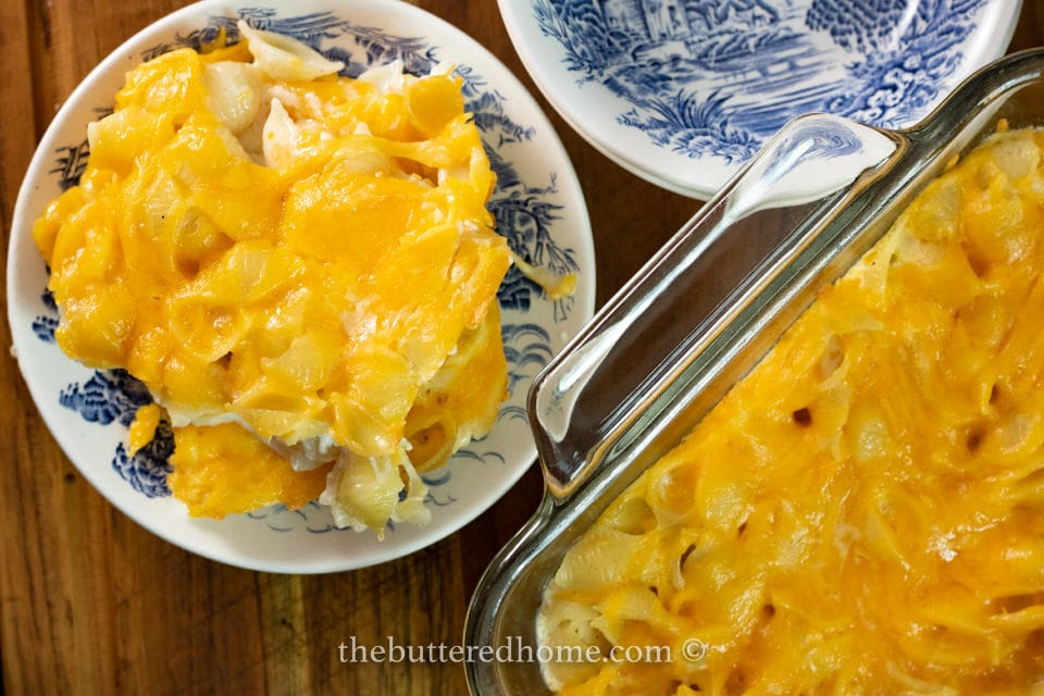overhead picture of macaroni and cheese on a blue and white plate