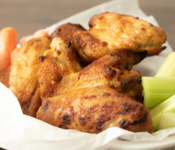 basket of chicken wings with veggies