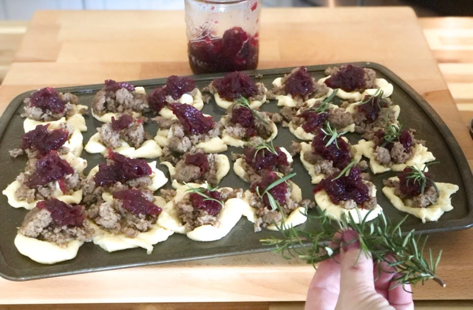 adding rosemary to tops of brie bites