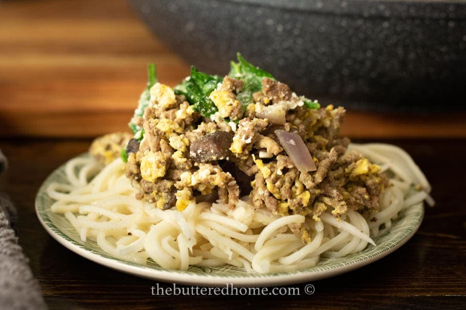 one serving of hamburger skillet on a bed of noodles