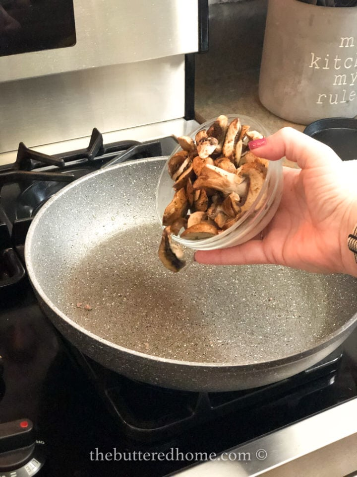 adding mushrooms to the skillet
