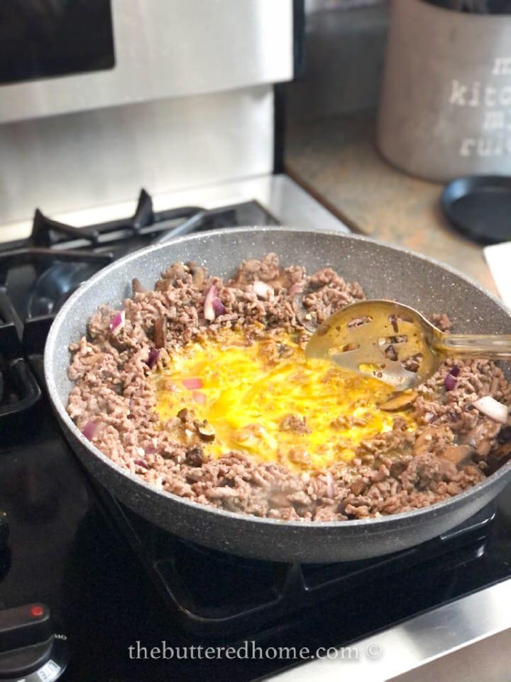 slowly cooking eggs until set